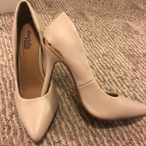 Cream Colored Pointed Pumps with Chrome Band